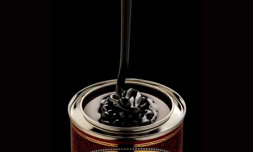 Black treacle pouring into tin