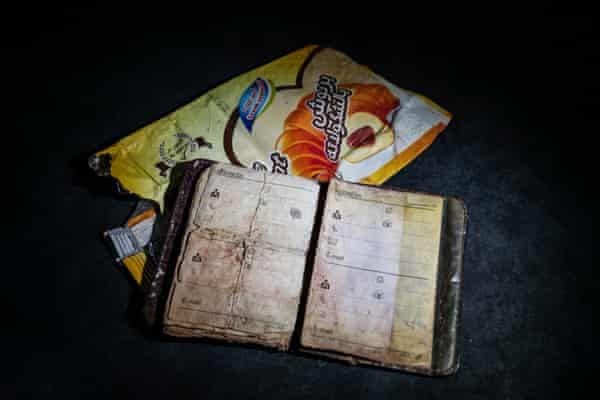 A contacts book and food packaging found on the body of a shipwrecked migrant