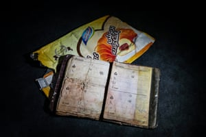 A phone book and a package of a croissant found on one of the bodies of a migrant found on a shipwreck in 2015.