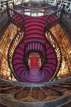 The spiral stairs at Livraria Lello & Irmão, Porto, Portugal.