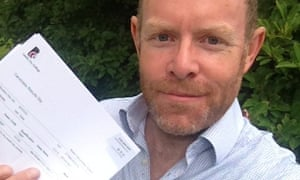 Giles holding GCSE results