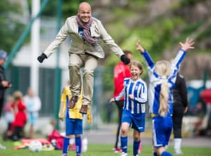 A dad cheers his daughter on the sports field in Helsinki, Finland. 'This is not about the mother's right or the father's right – but the child's right to spend time with both parents.'