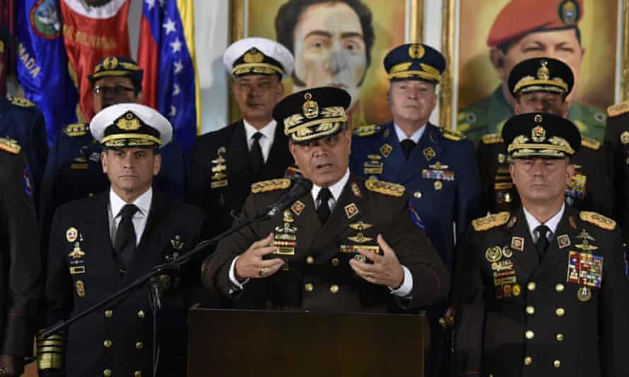 Venezuelan defence minister Vladimir Padrino Lopez (C) delivers a press conference in Caracas.