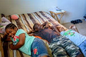 Cecelia Johnson, Elijah Cobb, and Noel Cobb lay on Cecelia and Wanda's bed in the Leonidas Neighborhood of New Orleans, La., on Friday, April 26, 2019.
