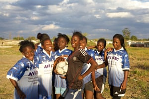 Girls take a break from training with their football team in Lusaka, Zambia