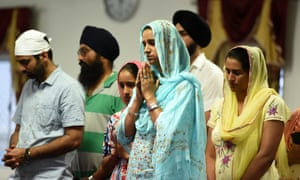 Mourners attend a vigil for bus driver Manmeet Alisher at a Sikh temple in Brisbane.