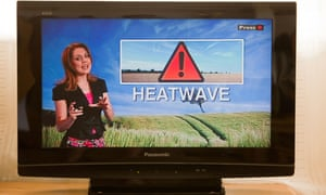 A TV weather presenter forecasting a heatwave in the UK