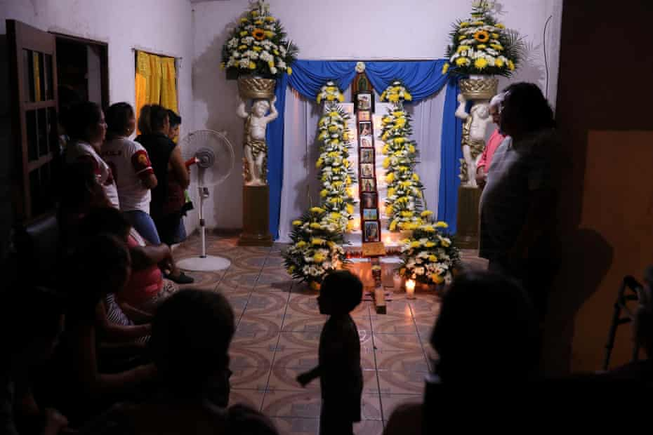 Relatives of Medel Huesca, a Mexican migrant who died of Covid-19 in New York, prays during the commemoration of the nine days of death, in the community of Carretas, Veracruz, Mexico, on April 14, 2020.