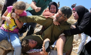 Ahed Tamimi bites the soldier's hand.