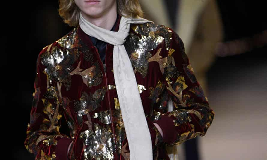 A model presents a 70s-inspired creation for Celine during Paris fashion week.