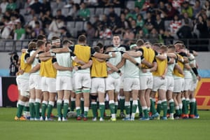 Ireland players huddle as they take the field before the match.
