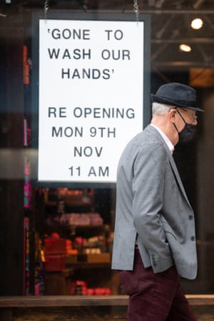 A man wearing a face covering walks past a Lush retail store on 25 October, 2020 in Cardiff, Wales. Wales entered a national lockdown on Friday evening which will remain in place until 9 November.