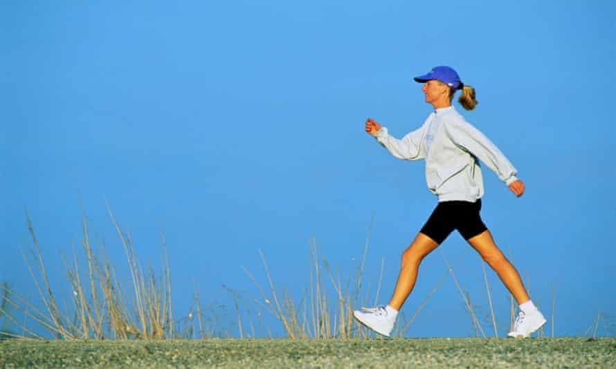 Woman speed walking.
