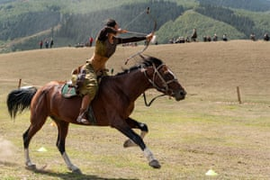 Aida Akhmatova from Kyrgyzstan fires at a target from a horse as she competes in mounted archery