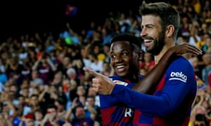 Barcelona's Spanish defender Gerard Pique (right) is congratulated by teammate Ansu Fati after scoring.