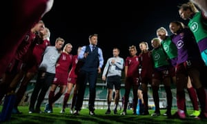 Phil Neville talks to his players at the end of last month's match against Portugal.