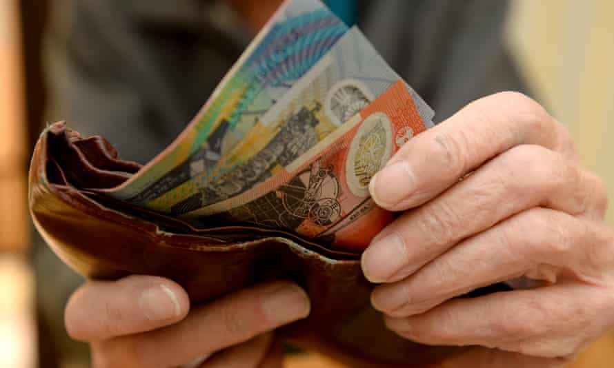 Money is taken out of a wallet Canberra, April 8, 2014.