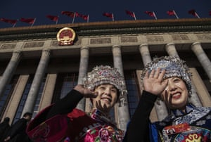 Two Miao women arrive for the third plenary session of the NPC