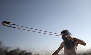 Jabaliya , Gaza StripA protester slings a stone during clashes between Israeli troops and Palestinian protesters near the border, between Israel and Gaza Strip