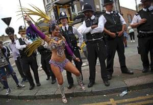 Police look as a performer dances