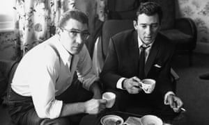 The gangsters Ronnie and Reggie Kray at home having a cup of tea.
