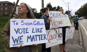 Demonstrators hold signs outside St Anselm College in Manchester, New Hampshire, where Susan Collins, one of the few possible Republican no votes on Kavanaugh, was scheduled to speak.
