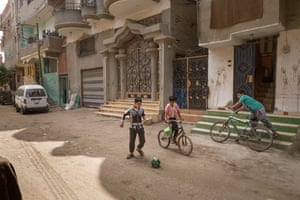 Children play football in front of Mohamed Salah's family home in Nagrig, Egypt