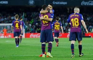 Messi celebrates scoring their second goal with Luis Suarez