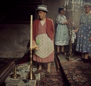 Miss Katie Newell cleaning brasses at Radwinter, Essex. Observer Magazine shoot August 1966