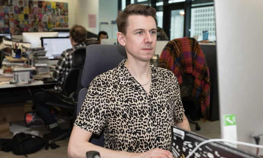 Tim Jonze in a New Look shirt at his desk in the Guardian office.