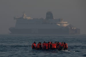 English Channel, UKAn inflatable craft carrying crosses the shipping lane in the English Channe. Earlier this week 430 migrants crossed the channel from France, a record for a single day
