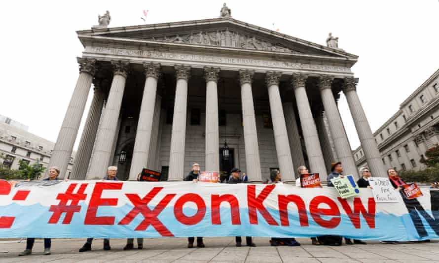 Climate protesters in October 2019 outside the New York county courthouse, where the trial against Exxon took place.