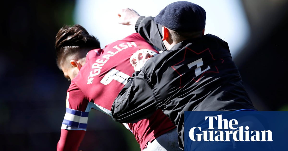 Jack Grealish punched by pitch invader during derby clash