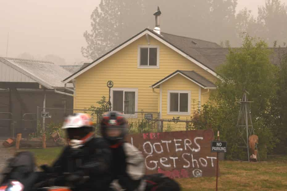 """A sign reads """"Looters Get Shot"""" outside a residence in Molalla, Oregon on September 13, 2020 which has been evacuated due to the Riverside Fire."""