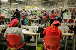 Workers sew clothes at a textile factory in Hawassa industrial park, Ethiopia