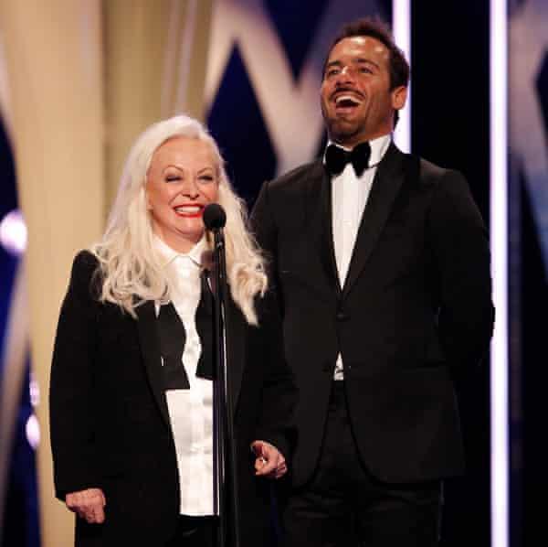 Jacki Weaver and Alex Dimitriades present an award