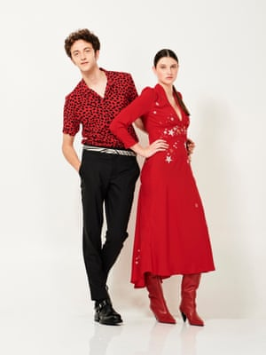 Animal instinct Niels wears short-sleeved shirt, £85, allsaints.com, trousers, £125, reiss.com, belt, £25.99, and shoes  £99.99, both zara.com. Lauren wears red star embroidery V-neck midi dress, £305, rixo.co.uk, and red high-leg leather boots, £149.99, mango.com