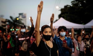 Protesters in Bangkok with arms raised