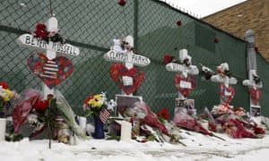 Crosses are placed for the victims of a mass shooting on Sunday, in Aurora, Illinois, near Henry Pratt Company where five people were killed on Friday.