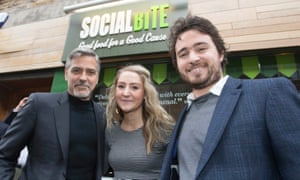 George Clooney meets Social Bite founders Alice Thompson and Josh Littlejohn at the Edinburgh sandwich shop in 2015.