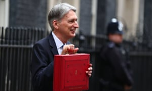 Hammond holds his ministerial red box outside 11 Downing Street before heading to the Commons to deliver the budget