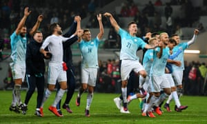 Slovenia players celebrate the draw.