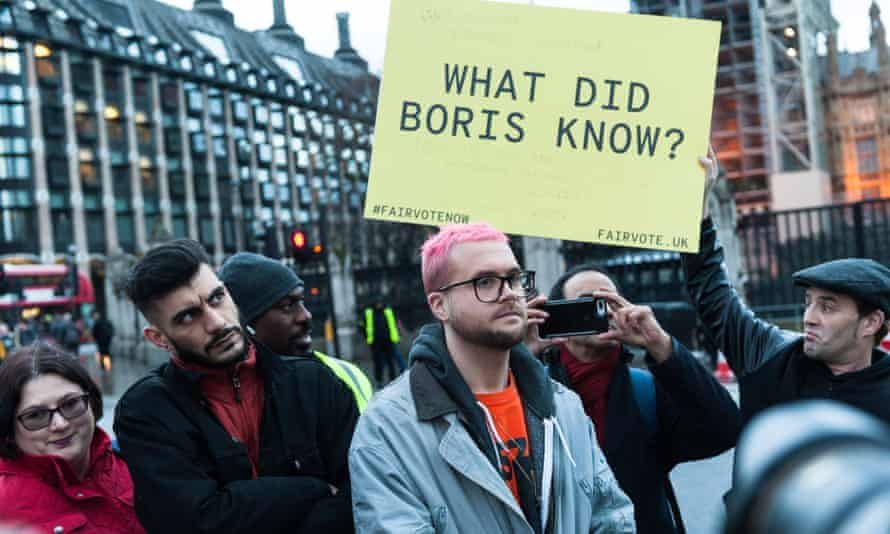 BeLeave and Cambridge Analytica whistleblowers Shahmir Sanni and Chris Wylie at a demonstration in Parliament Square.