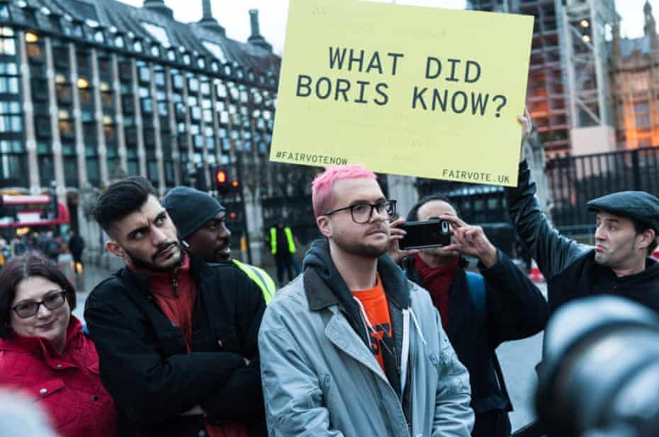 Shahmir Sanni and Chris Wylie attend a demonstration outside parliament.