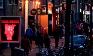 People in the red light district in Amsterdam after brothels reopened after the coronavirus shutdown.