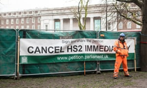 A security guard guards construction work at Euston station after anti-HS2 campaigners chained themselves to a tree to protest against the project.