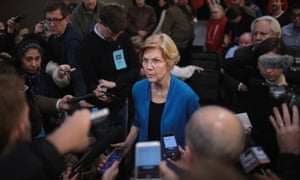 Elizabeth Warren speaks to reporters during a campaign stop at McCoy's Bar Patio and Grill.