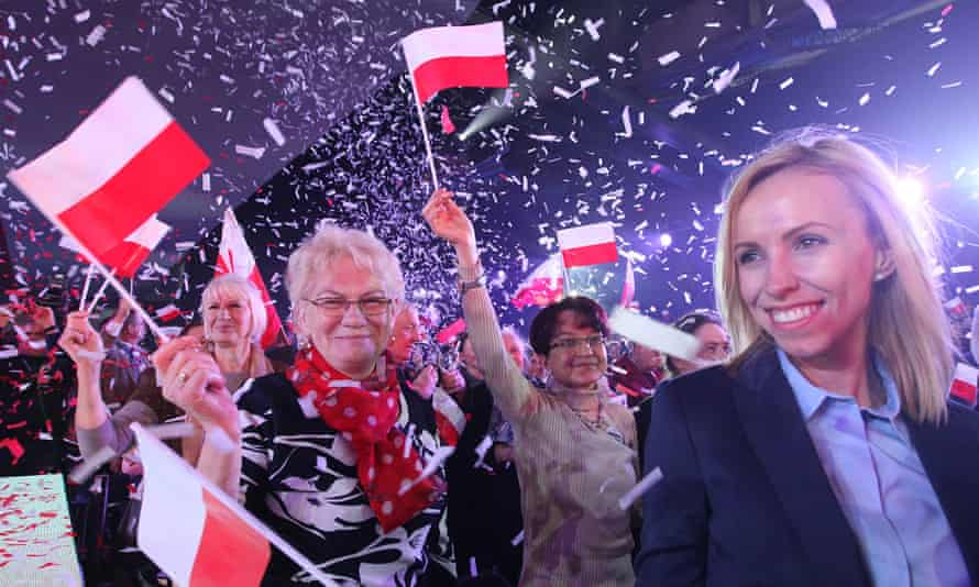 Supporters for the conservative opposition Law and Justice party at a rally in Warsaw.