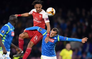 Pierre-Emerick Aubameyang of Arsenal wins a header over Vlad Chiriches of Napoli.