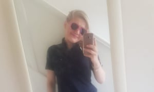 Izabela Ceckowska wearing sunglasses takes a selfie in a mirror at her home during the lockdown.